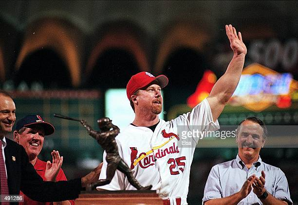 Mark McGwire of the St Louis Cardinals waves to the fans after his 500th home run during the game against San Diego Padres at Busch Stadium in St...