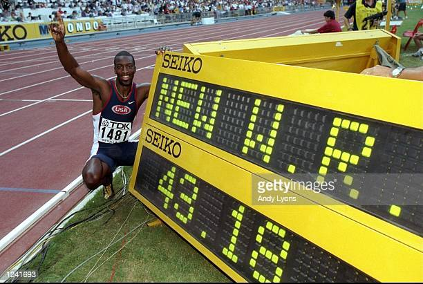 Michael Johnson of the USA celebrates his World Record race after winning the 400m in a time of 4318 seconds at the 1999 World Championships held at...