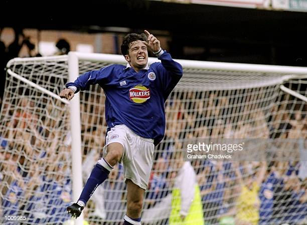 Muzzy Izzet of Leicester City celebrates his goal from the penaltyspot to put his team in the lead during the FA Carling Premiership match against...