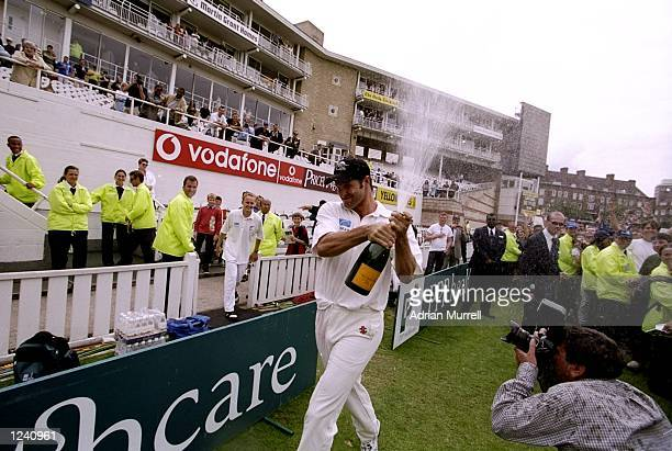 New Zealand's Chris Cairns celebrates victory in the fourth Test against England played at the Oval in London, England. Tne Kiwis won the match by 83...