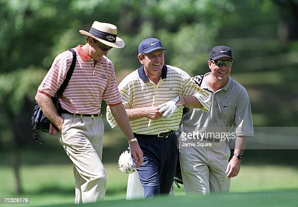 Nick Price walks with David Leadbetter and caddie Jimmy Johnson during the PGA Championships at the Medinah Country Club in Medinah Illinois...