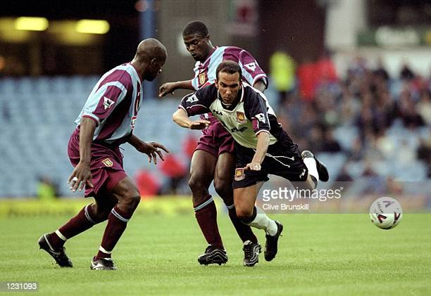 Paolo Di Canio of West Ham United takes on Aston Villa's George Boateng and Ugo Ehiogu in the FA Carling Premiership match at Villa Park in...