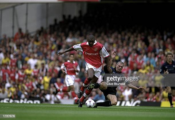 Patrick Vieira of Arsenal is tackled by Roy Keane of Manchester United during the FA Carling Premiership match against Manchester United played at...
