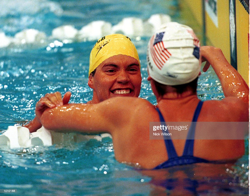 Penny Heyns of South Africa is congratulated by Kristy Kowal of USA after winning the 100 metres breastroke gold medal during day three of the Pan Pacific Swimming Championships at the Aquatic Centre, Homebush, Sydney, Australia. MandatoryCredit: Nick Wilson/ALLSPORT