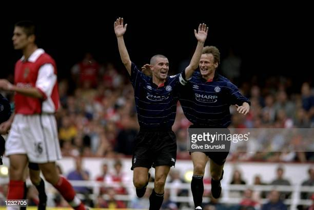 Roy Keane of Manchester United celebrates scoring the winning goal with Teddy Sheringham during the FA Carling Premiership match against Arsenal...