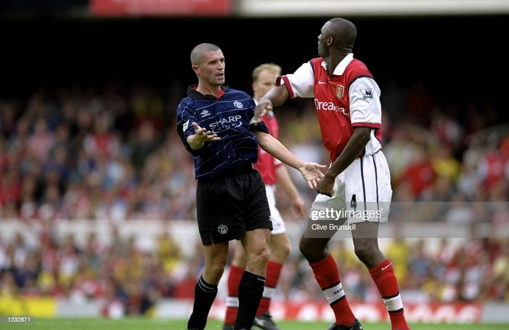Roy Keane of Manchester United clashes with Patrick Vieira of Arsenal during the FA Carling Premiership match against Arsenal played at Highbury in London, England. The match finished in a 2-1 win to Manchester United. \ Mandatory Credit:Clive Brunskill /Allsport