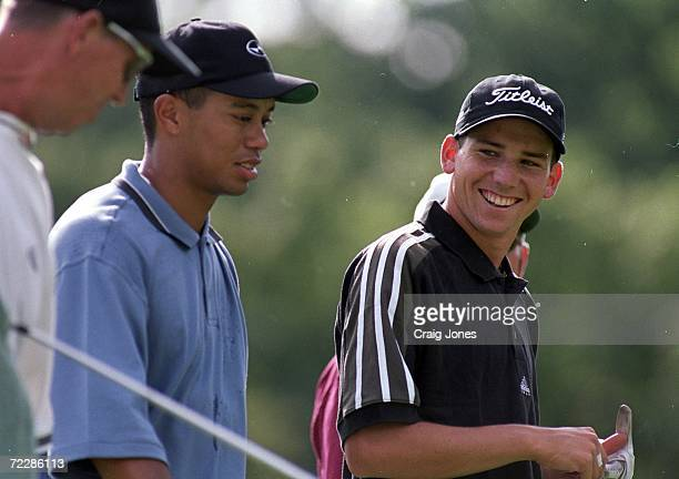 Sergio Garcia smiles at Tiger Woods as they walk together during the PGA Championships at the Medinah Country Club in Medinah Illinois