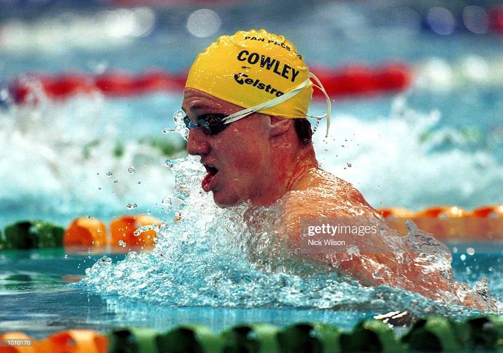 Simon Cowley of Australia on his way to winning the 100 metres breaststroke gold medal at the Pan Pacific Swimming Championships at the Aquatic Centre, Homebush, Sydney, Australia. Mandatory Credit: Nick Wilson/ALLSPORT