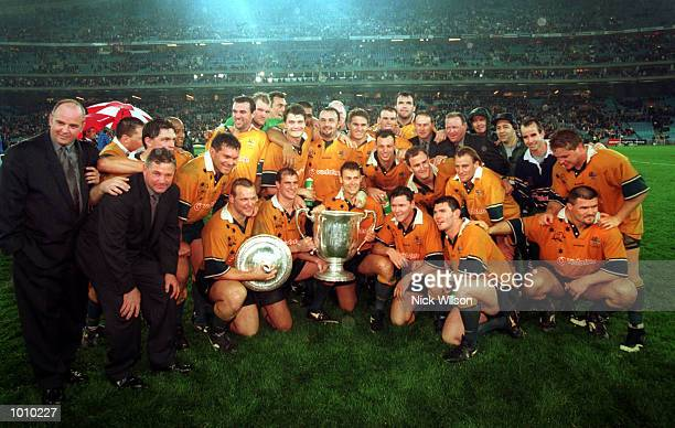 The Australian team celebrate with the Bledisloe Cup in front of a new world record crowd of 108000 for a rugby union international during the...
