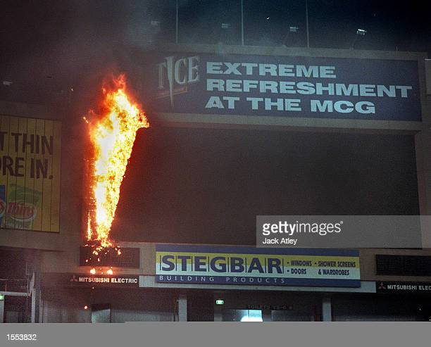 The crowd evacuate the Ponsford Stand as a fire breaks out in the main scoreboard at The Melbourne Cricket Ground Players and officials were warming...