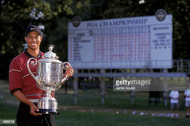 Tiger Woods poses with his trophy after winning the PGA Championships at the Medinah Country Club in Medinah, Illinois. Mandatory Credit: Jamie...
