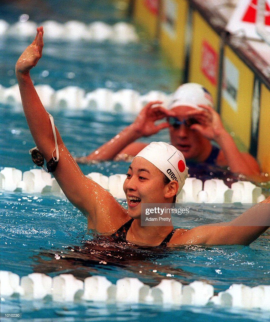 Tomoko Hagiwara of Japan celebrates winning the womens 200 metres backstroke gold medal during day seven of the Pan Pacific Swimming Championships at the Aquatic Centre, Homebush, Sydney, Australia. Mandatory Credit: Adam Pretty/ALLSPORT
