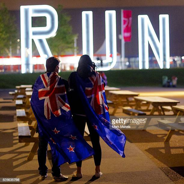Aug. 2, 2012 - London, England, United Kingdom - New Zealand supporters take a photograph of the giant RUN sculpture outside the Copper Box during...