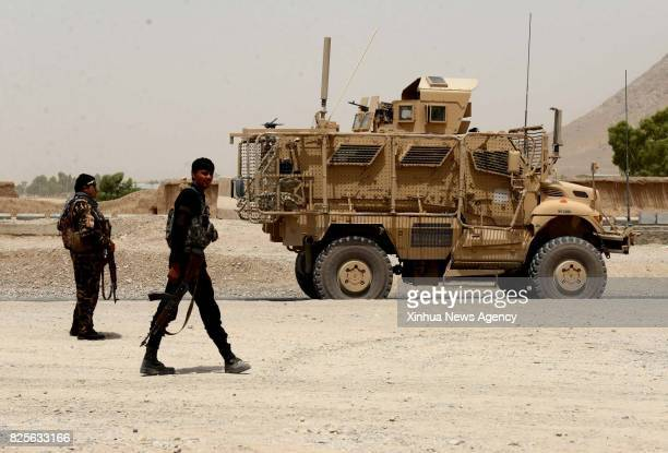 KANDAHAR Aug 2 2017 Afghan security force members walk at the site of an attack in Kandahar province Afghanistan Aug 2 2017 An explosion struck a...