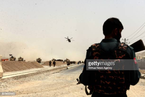 KANDAHAR Aug 2 2017 An Afghan security force member stands at the site of an attack in Kandahar province Afghanistan Aug 2 2017 An explosion struck a...