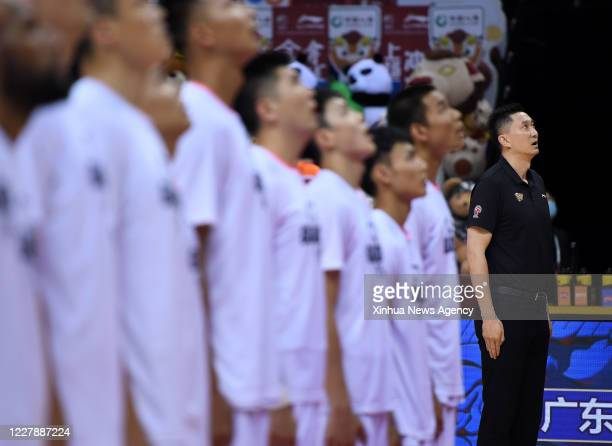 Aug. 2, 2020 -- Du Feng , head coach of Guangdong Southern Tigers, attends the anthem ceremony before the quarterfinal between Guangdong Southern...