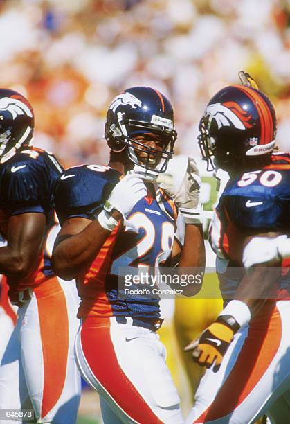 Kenoy Kennedy of the Denver Broncos celebrates during the Packers v Broncos game in which the Broncos defeated the Packers 2620 at Mile High Stadium...