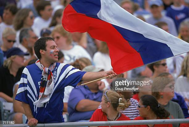 A fan of Team Russia waves a flag during the game against the USA at the NavyMarine Corps Memorial Stadium in Annapolis Maryland The USA defeated...