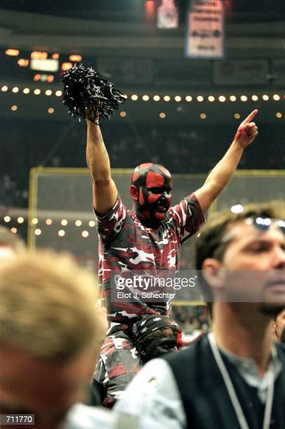 A fan of the Orlando Predators celebrates as he is dresses in team colors and painted face after the Arena Bowl Game against the Nashville Kats at...