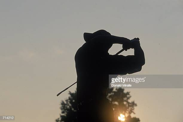 A silhouette of Tiger Woods at sunset during the NEC Invitational World Golf Championships at the Firestone Country Club in Akron OhioMandatory...