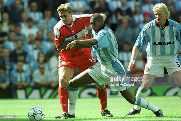 Alan Boksik of Middlesbrough battles with Carlton Palmer during the FA Carling Premiership game between Coventry City v Middlesbrough at Highfield...