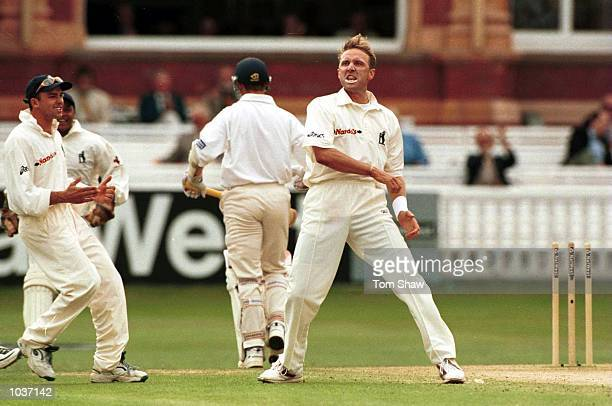 Allan Donald of Warwickshire celebrates taking the wicket of Tim Hancock of Gloucester during the Natwest Trophy final between Gloucester and...