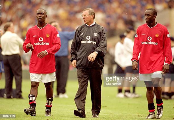 Andy Cole Manchester United manager Alex Ferguson and Dwight Yorke of Manchester United walk off after the Charity Shield match against Chelsea...