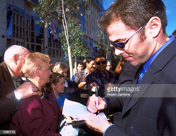 Australian cricketer Damien Martyn signs an autograph for a fan during a public appearance today at the City Square. The appearance of the Australian...