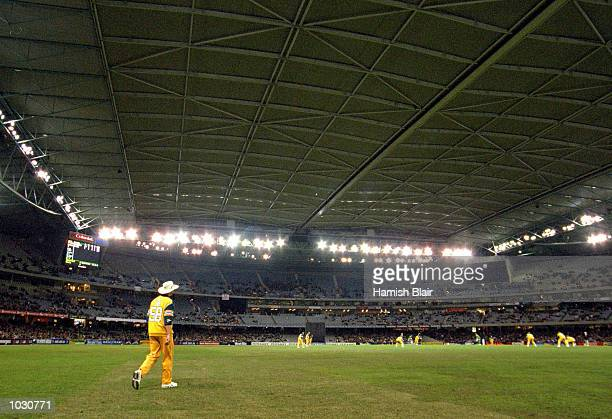 Brett Lee of Australia stands in the out field, in the match between Australia and South Africa, in game one of the Super Challenge 2000, played at...