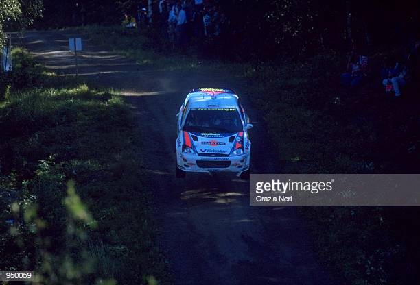 Carlos Sainz of Spain driving the Ford Focus WRC during the FIA World Rally Championship round 9 Finnish Rally at Jyvaskyla in Finland Mandatory...