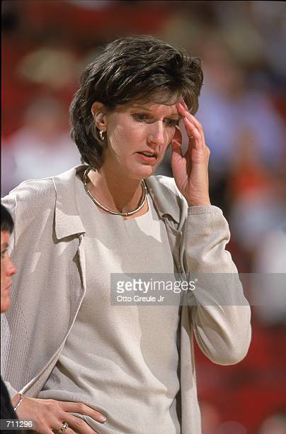 Coach Anne Donovan of the Indiana Fever thinks about the action during a game against the Seattle Storm at the Key Arena in Seattle Washington The...