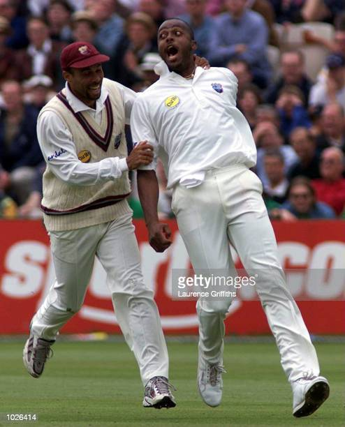 Courtney Walsh of the West Indies celebrates with Jimmy Adams after taking the wicket of Graham Thorpe of England during the second day of the...