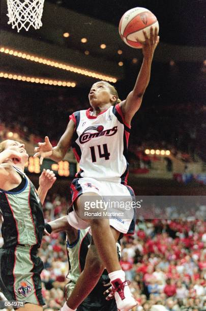 Cynthia Cooper of the Houston Comets makes a layup during the game against the New York Liberty at the Compaq Center in Houston Texas The Comets...