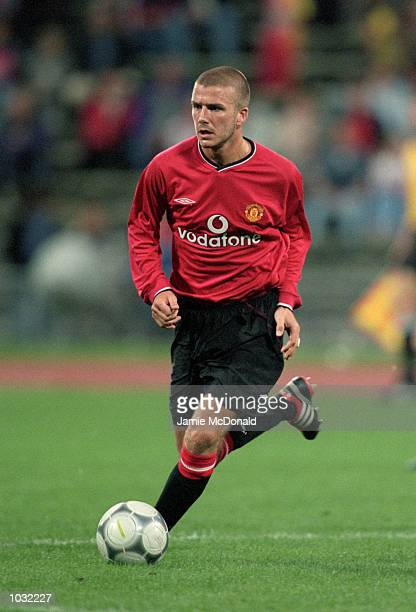 David Beckham of Manchester United on the ball during the preseason Bayern Munich Centenary Tournament friendly match against Real Madrid at the...