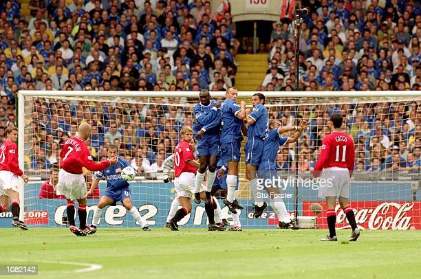 David Beckham of Manchester United takes a freekick during the Charity Shield match against Chelsea played at Wembley Stadium in London Chelsea won...