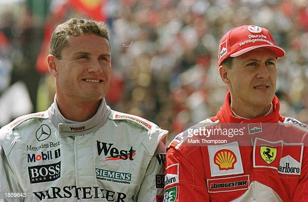 David Coulthard of Great Britain and Michael Schumacher of Germany during the qualifying session for the Hungarian Grand Prix at Budapest Hungary...