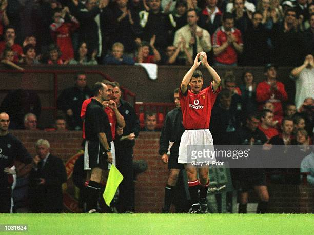 Denis Irwin of Man Utd salutes the fans as he leaves the pitch injured during the Manchester United v Manchester City Denis Irwin Testimonial match...