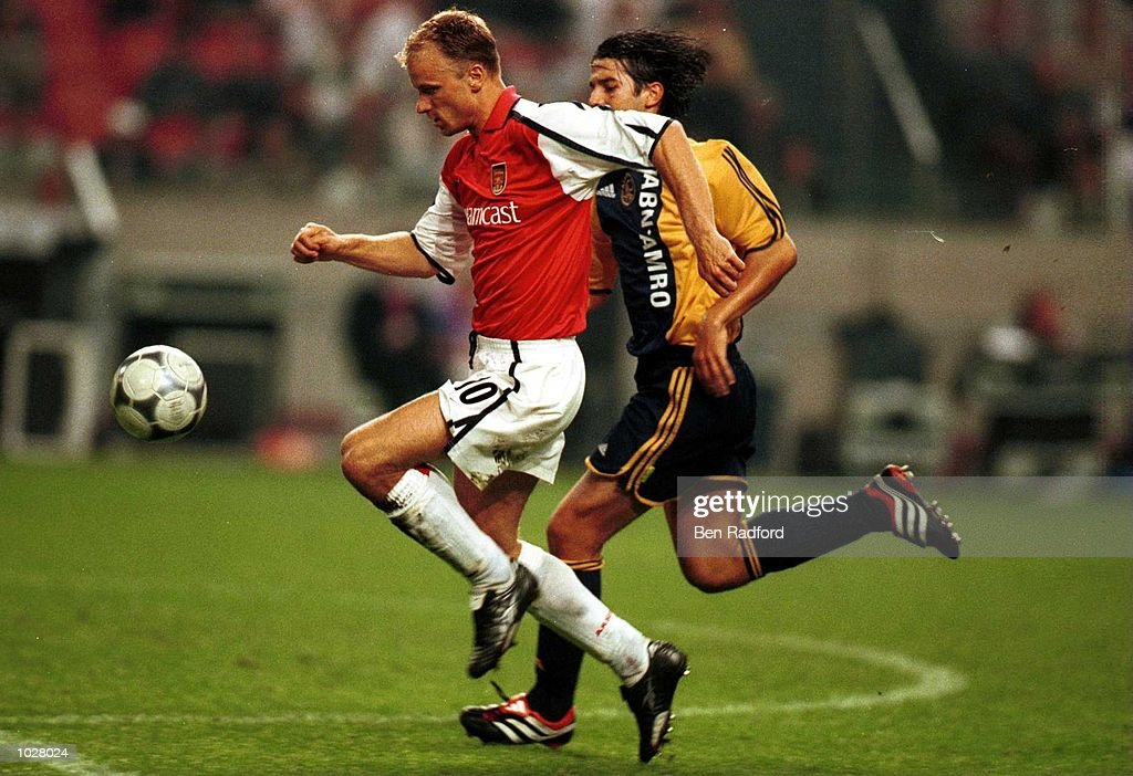 Arsenal v ajax pictures getty images dennis bergkamp of arsenal gets away from cristian chivu of ajax during the match between arsenal thecheapjerseys