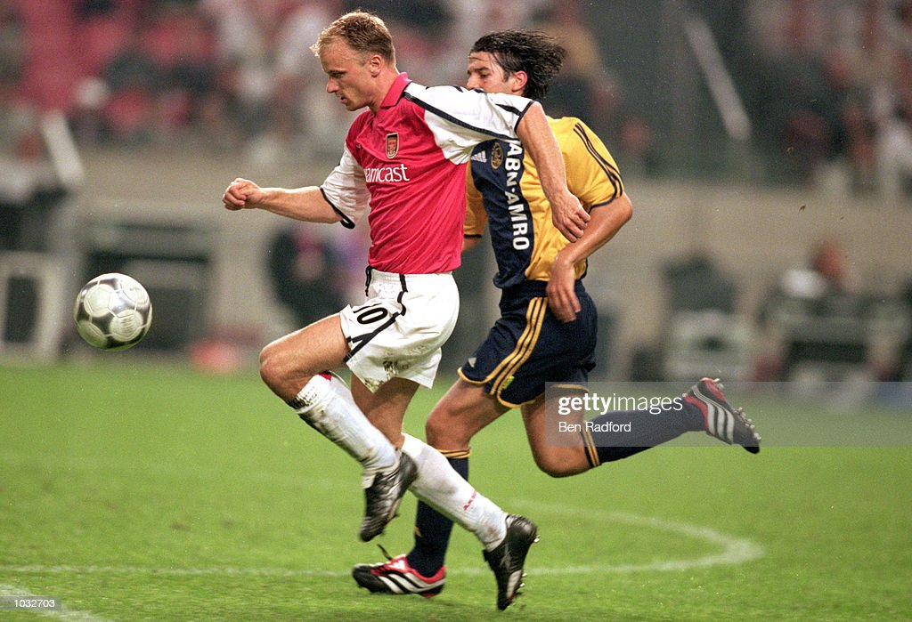 Dennis bergkamp cristian chivu pictures getty images dennis bergkamp left of arsenal holds off cristian chivu of ajax during a pre thecheapjerseys
