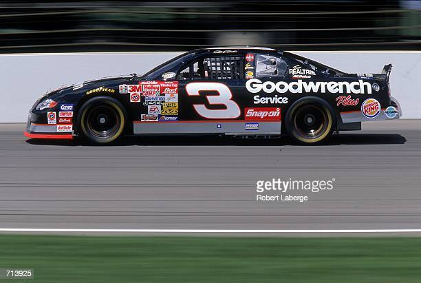 Driver Dale Earnhardt who drives a Chevrolet Monte Carlo for Richard Childress Racing speeds down the track during the Brickyard 400 part of the...