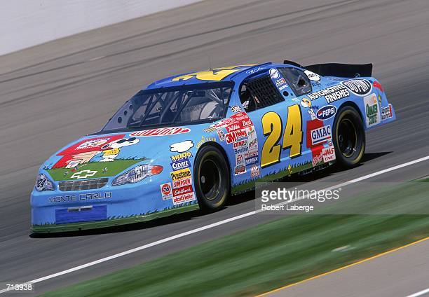 Driver Jeff Gordon who drives a Chevrolet Monte Carlo for Hendricks Motorsports speeds down the track during the Brickyard 400 part of the NASCAR...