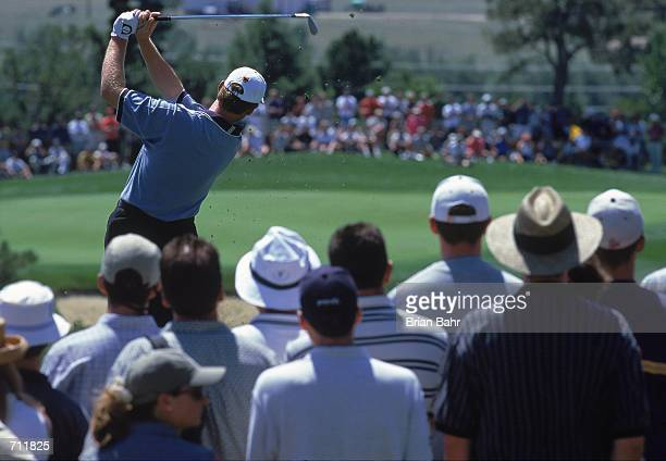 Ernie Els watches his ball fly while surrounded by fans during The International presented by QWest part of the PGA Tour at the Castle Pines Golf...