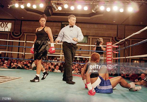 Freeda Foreman walks in the ring as she watches LaQuanda Landers attempt to get up during a fight at the Regent Hotel in Las Vegas Nevada Foreman...