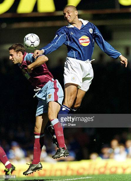 Gareth Southgate of Aston Villa clashes with Stan Collymore of Leicester City during the FA Carling Premiership game between Leicester City v Aston...