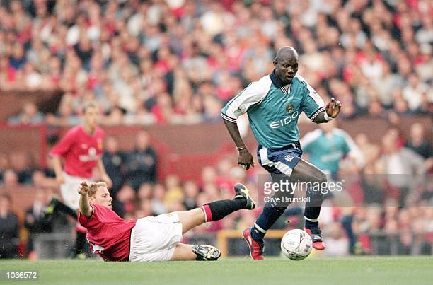 George Weah of Manchester City evades a challenge from Nicky Butt of Manchester United during the Denis Irwin Testimonial match at Old Trafford in...