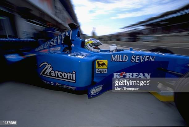Giancarlo Fisichella pulls out of the garage in his Benetton before the Formula One Hungarian Grand Prix at the Hungaroring near Budapest in Hungary...