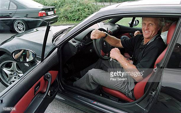 Greg Norman of Australia and the Prince of Bavaria test the BMW Z3 M Roadster at the high security BMW test track after the first round of the BMW...