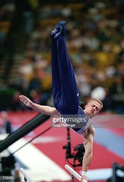 Guard Young performs his routine in the Parrell Bars Event during the US Olympic Men's Gymnastics Trials at the Fleet Center in Boston...