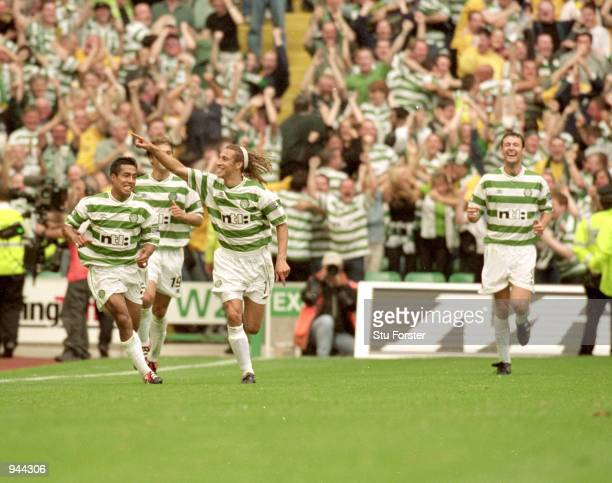 Henrik Larsson of Celtic celebrates during the Scottish Premier League match against Rangers at Celtic Park in Glasgow Scotland Celtic won the game 6...