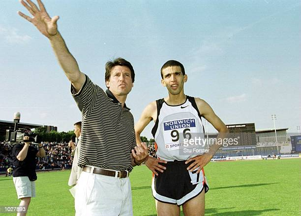 Hicham El Guerrouj of Morocco with Sebastian Coe after winning the Emsley Carr 1 Mile race at the Norwich Union British Grand Prix Athletics at...